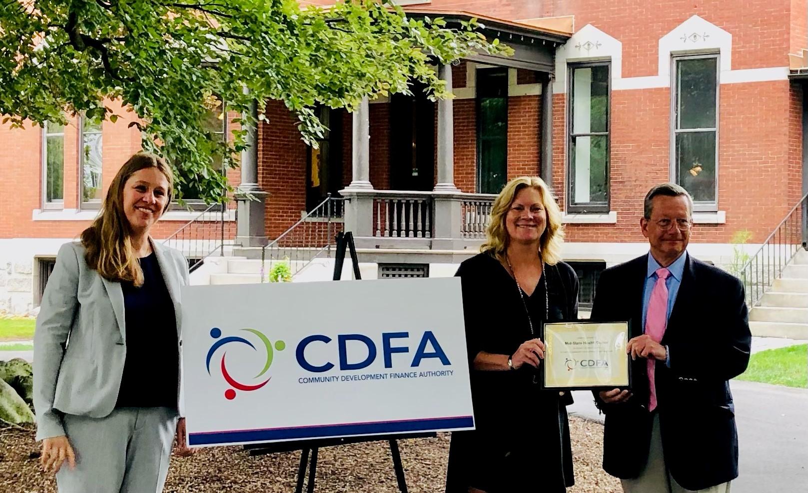Audrey Goudie and Robert MacLeod accepting CDFA award
